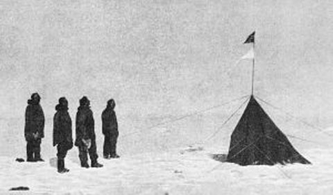 Roald Amundsen's crew at the South Pole. From left to right: Roald Amundsen, Helmer Hanssen, Sverre Hassel and Oscar Wisting. New research shows warm weather and good conditions were a boon to Amundsen's crew during their race to the South Pole but hindered the progress of Robert Falcon Scott's crew across the Ross Ice Shelf. Credit: Roald Amundsen; public domain.