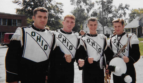 Starkey was a four-year member of the Marching 110, shown here in band uniform with three others.