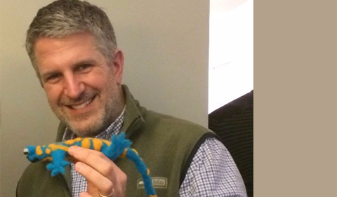 Dr. David Weisrock, shown holding a stuff toy lizard