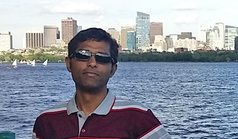 Dr. Gaurav Sinha, shown in photo with city in background