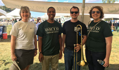 Dr. Jennifer Hines and alumni at Homecoming. McCullough with trombone.