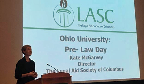 Kate McGarvey delivers Pre-Law Day keynote, shown here standing at the podium.