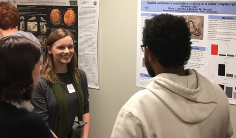 Undergraduate Olivia Brooks presents her poster at the herpetology symposium. Brooks works with Maggie Hantak, a Ph.D. student in the Kuchta lab in the Biological Sciences Department.