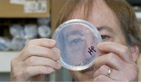 Dr. Richard Jones, shown here looking through a petri dish.