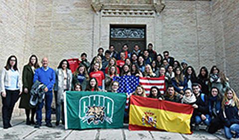 Students during Spring 2017 semester in Toledo, Spain, posing with two Spain and Ohio University flags.,