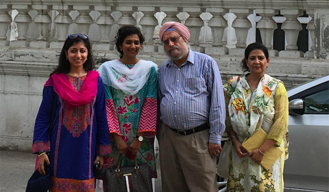 Dr. Amritjit Singh was invited to tour the Quaid-e-Azam Library in Lahore, shown here with three women posing for group photo.