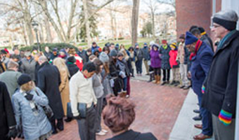 Marchers pray at Galbreath Chapel during a past MLK Jr. Silent March event.