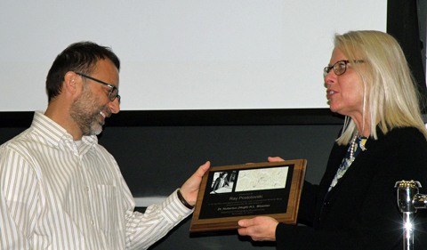 Department chair, Dr. Dorothy Sack on right, presents Ray Postolovski with a plaque