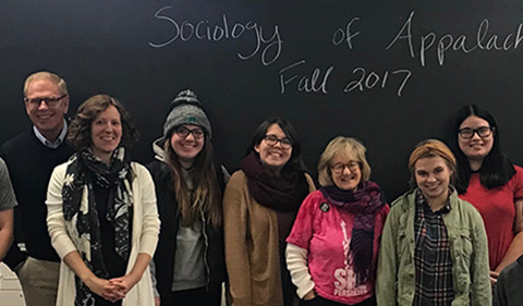From left, former Ohio Gov. Ted Strickland, Dr. Rachel Terman, Kaitlyn McNeely, Samantha Miller, Amoriya, Hannah Veerkamp, Wendy Weyers. Group shot of seven people in front of blackboard that says Sociology of Applachia Fall 2017.