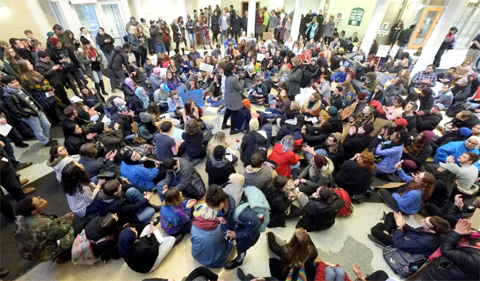 The exhibition commemorates the Feb. 1, 2017, demonstration that resulted in the arrests of 70 students and community members in Baker Center. Photo shows fisheye view of protest.