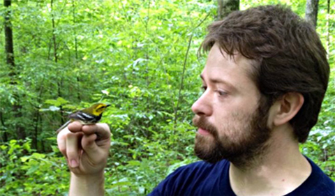 Brandan Gray, with gold finch on his hand