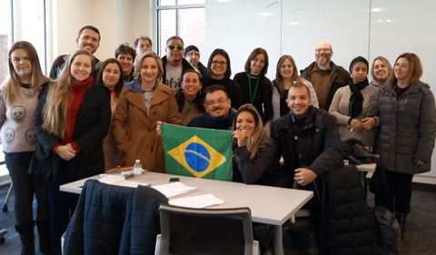 Brazilian teachers participating in the PDPI Brazil English Teachers Program pose for a photo with Aaron Schwartz, an associate lecturer in OPIE, at OHIO's Living Learning Center.
