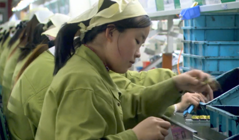 Death by Design documentary, showing Chinese workers making cell phone components
