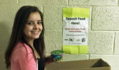 Lauren Conner with her food drive box.