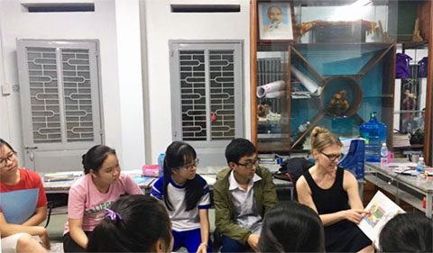 Bikowski working with teenagers in Vietnam for a U.S. State Department program titled Access