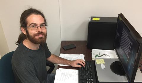 Matt Brooks at his work station in Ohio University's Edwards Accelerator Lab