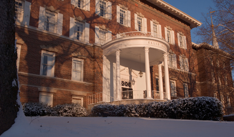 Ellis Hall, shown from east with front portico and white columns.