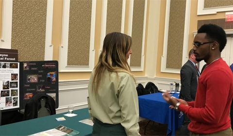 A student talks with a representative from the Wayne National Forest.