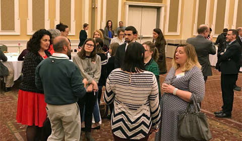 Students and alumni network in the ballroom.