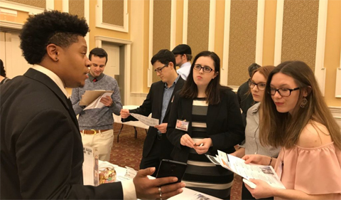 Students visit with alumni, corporate and non-profit recruiters.