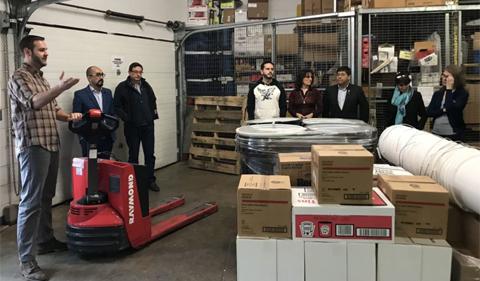 PUCE visitors at ACEnet, photo inside warehouse