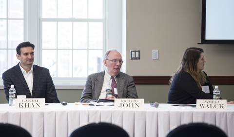 From left, panelists Laeeq Khan, Richard John and Pamela Walck at table
