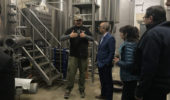 Jackie O's owner Art Oestrike gives visitors a tour at Jackie O's brewery.