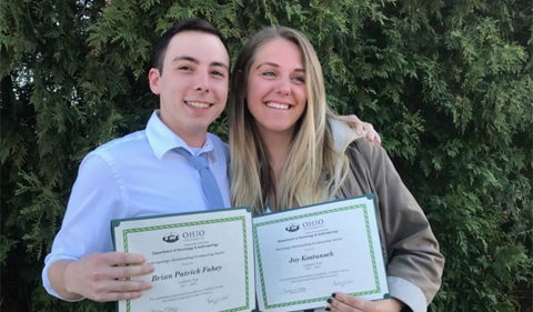 Patrick Fahey and Joy Kostansek received the anthropology and sociology senior awards, posing here with their certificates.