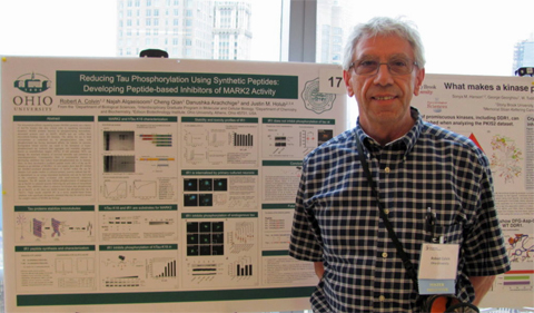 "Dr. Robert Colvin presents at a confrence on ""Thinking Outside the ATP Box: New ways to Target Kinases for Therapeutics."""
