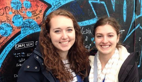CLJC students in Northern Ireland, in front of graffiti wall