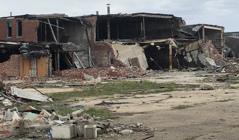 """The Mosaic Tile Property is a """"brownfield"""" site up for redevelopment. Photo shows a partially collapsed two-story building."""