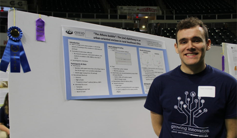 Peter Andrews, Blue Ribbon Winner at Student Research Expo, pictured with poster and blue ribbon