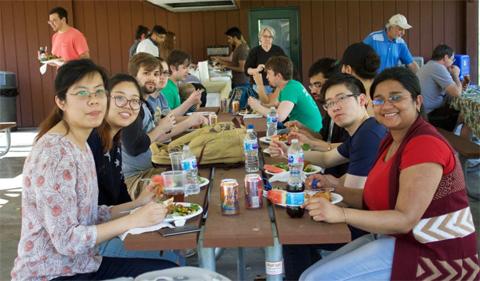 At picnic table, left: Yuan Zhang, Jingwen Song Right: Proma Basu, Quyen Luong, Pratik Shriwas
