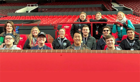 Students prepare to watch an English Premiership football match in Stoke City, England, shown here sitting in the stands at the stadium.