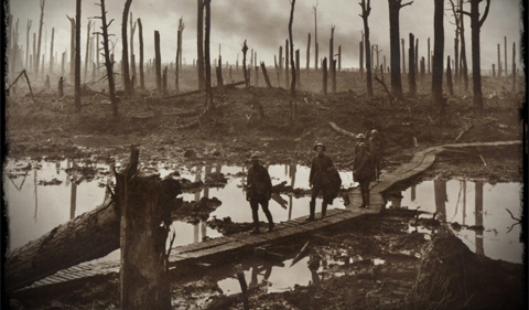 world war i photo of bombed out, denuded forest with five soldiers walking