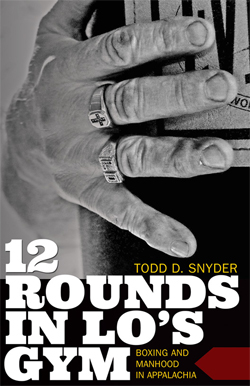 Book cover for 12 Rounds in Lo's Gym: Boxing and Manhood in Appalachia, shows close-up of hand holding heavy bag