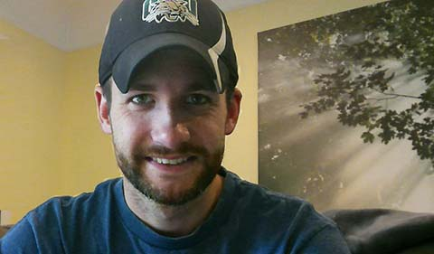 A smiling Rhett Butcher in an Ohio University baseball cap