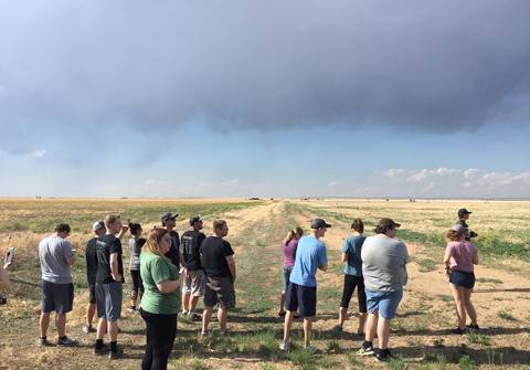 "Students stopped to check out a low precipitation supercell that had fired in northeast New Mexico, which the group affectionately named ""Larry"" before the updraft collapsed."