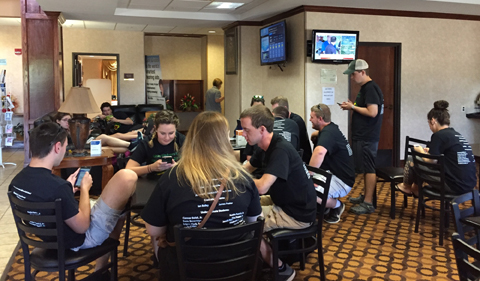 Students wait eagerly in a hotel lobby as a new outlook from the Storm Prediction Center was being issued.