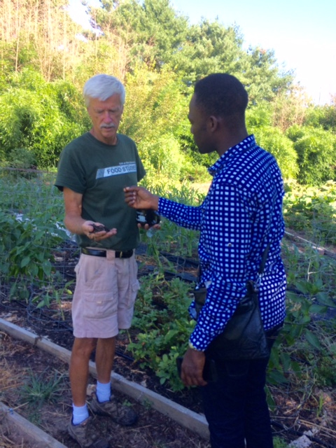 Art Trese talks about the soil at the Student Farm, shown here with a handful of dirt.