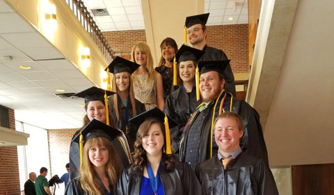 2018 Forensic Chemistry graduates in their academic regalia.