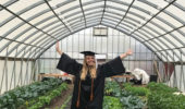 Joy Kostansek in the high tunnel at the OHIO Student Garden.