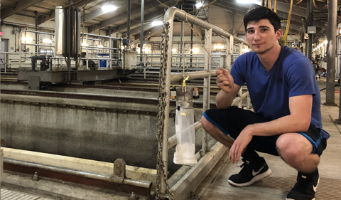 Honors Tutorial College student Mitch Duffner with bioassaying flashing LED lights, mimicking midge wingbeat frequencies at Alum Creek Water Reclamation Facility.