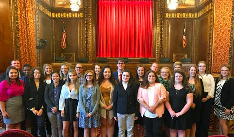 Summer Law & Trial Institute students at the Supreme Court of Ohio, standing in front of the justice's bench.