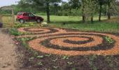 Two spiral pathways, emulating the design of an antique McArthur Brick Plant brick.
