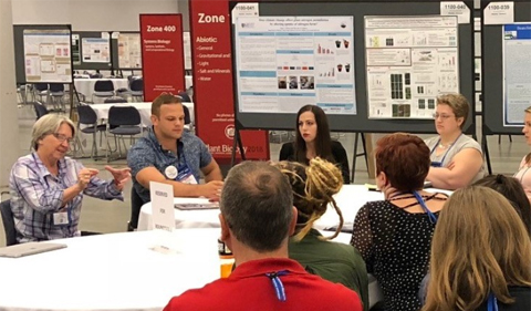 Dr. Sarah Wyatt and graduate student Al Meyers lead a round table discussion on Plant Space Biology.