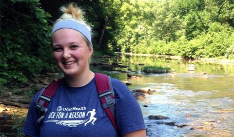 Amanda Szinte, portrait outdoors near stream