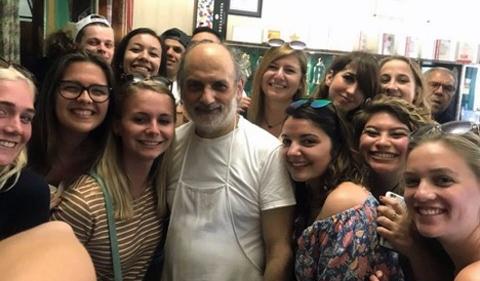 "Food in Sicily students ""mob"" Chef Corrado Assenza in Caffé Sicilia, Noto, Sicily, shown here in a group photo."