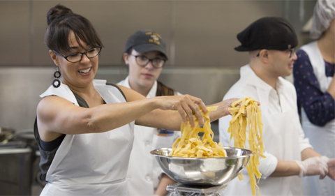 Karima Moyer-Nocchi portions out fresh, hand-made pasta noodles to be boiled.