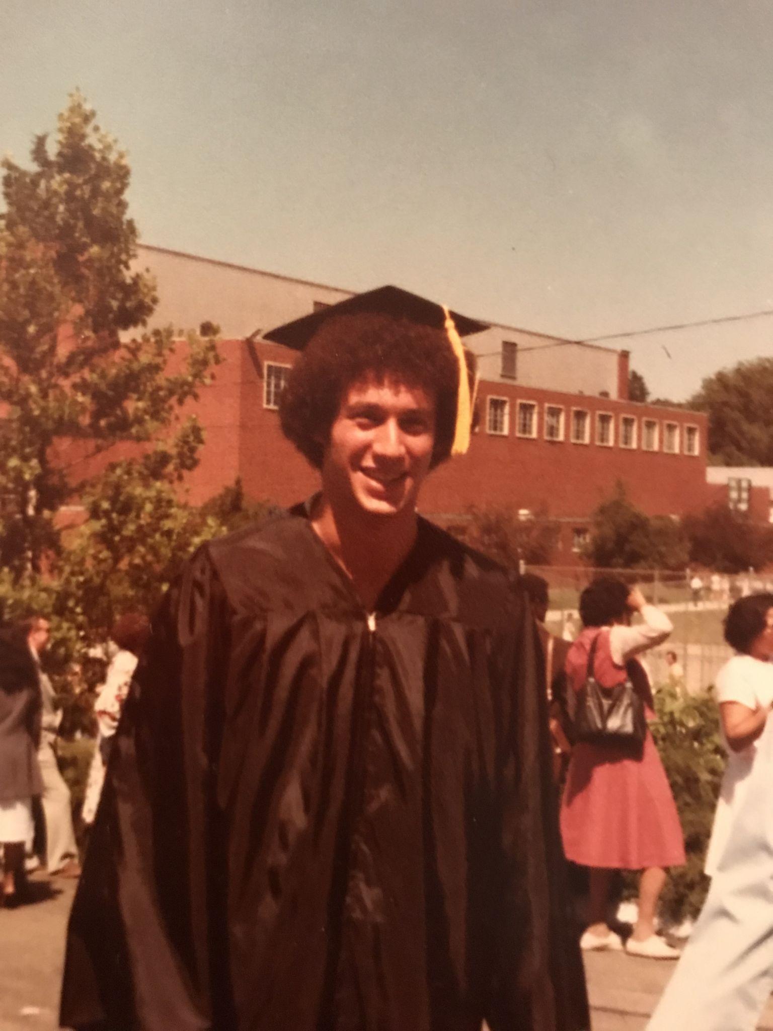Man wearing graduation regalia